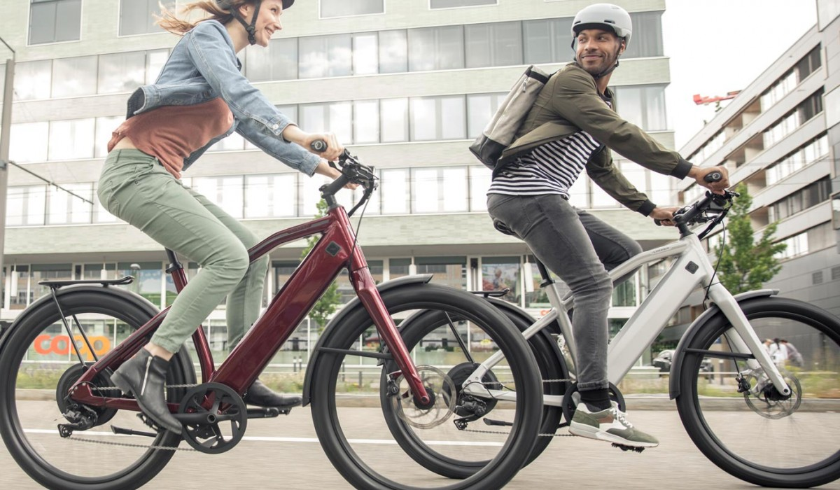 Couple riding Stromer bikes