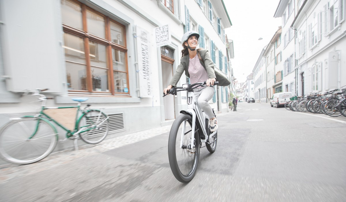 Young woman with her Stromer ST3 business bike on the way to work.